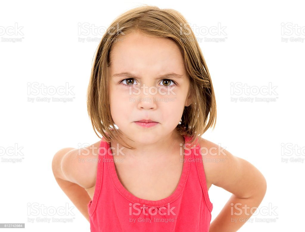 Little girl is angry, mad and looking at the camera stock photo