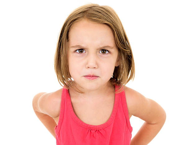 Little girl is angry, mad and looking at the camera Little girl is angry, mad and looking at the camera. Emotion face. puckering stock pictures, royalty-free photos & images