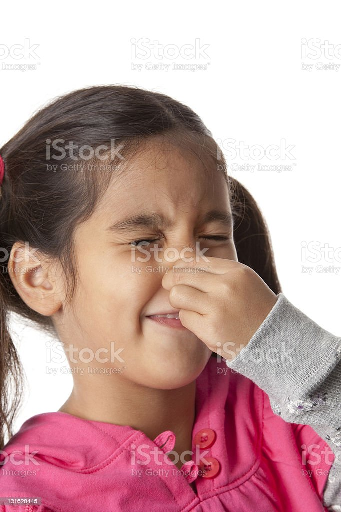 Little girl is closing nose with her fingers royalty-free stock photo