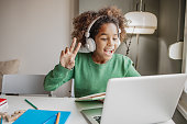 istock Little girl is communicating on a video call with teacher 1297657429