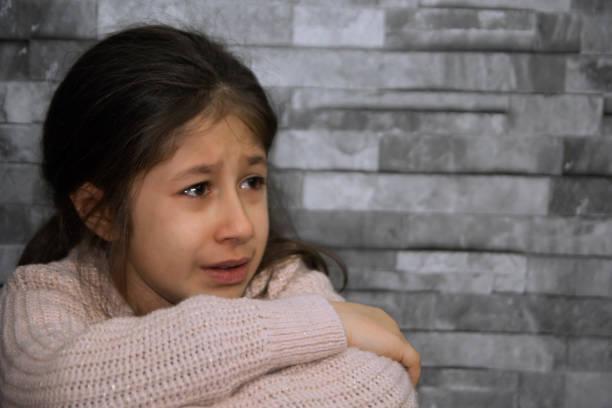 little girl is crying stock photo