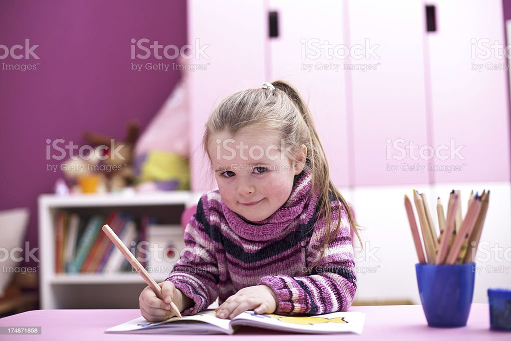 Little girl is drawing royalty-free stock photo