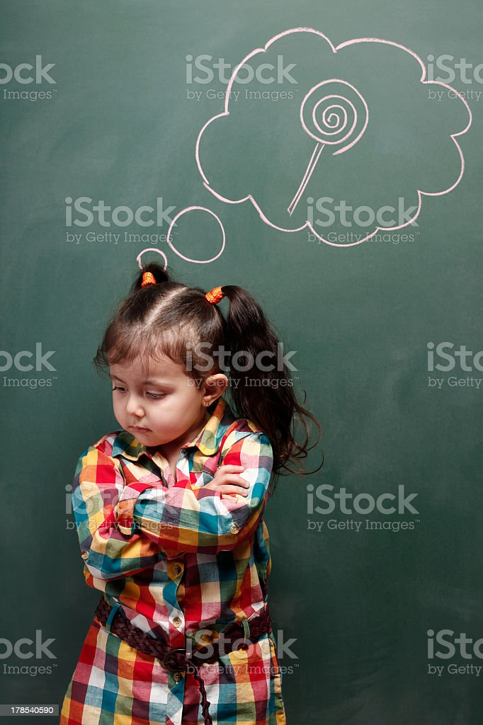 Little girl is dreaming a candy royalty-free stock photo