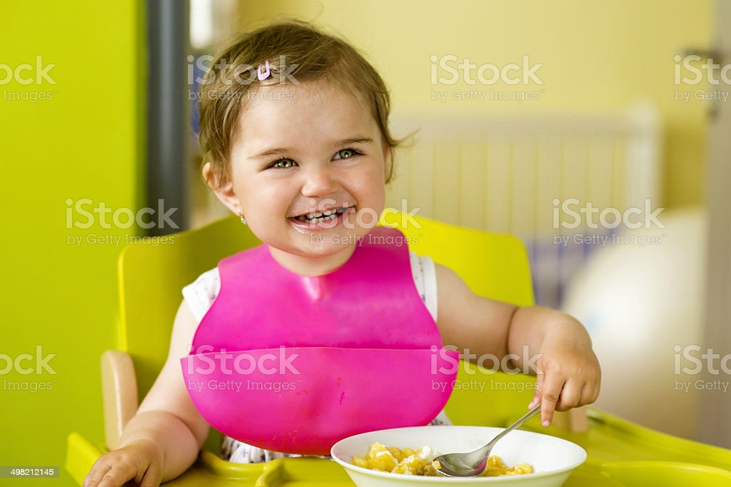 Little girl is eating stock photo