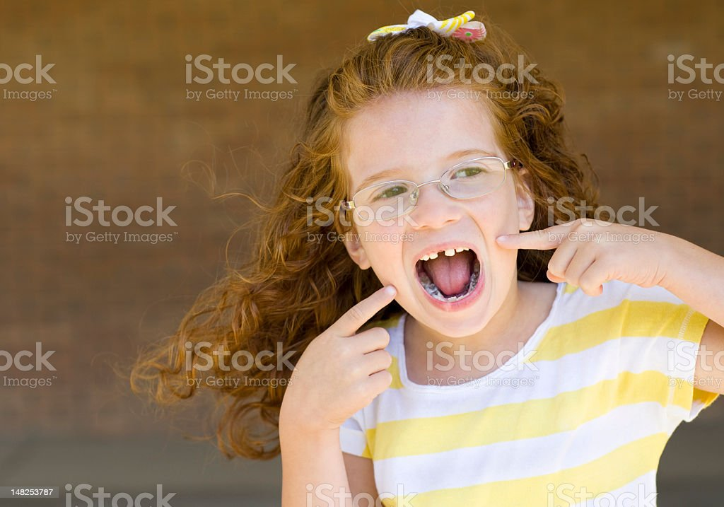 little girl is missing her top tooth royalty-free stock photo