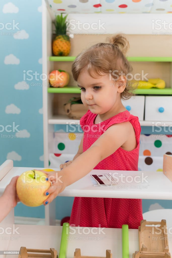 A little girl is playing in kindergarten stock photo