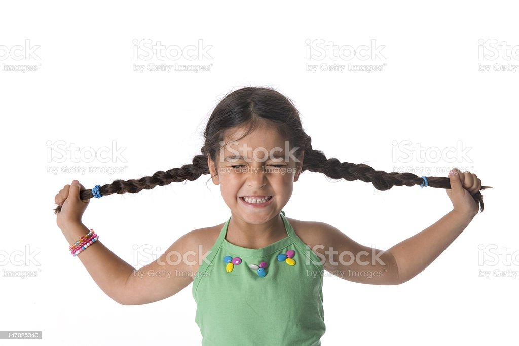 Little girl is pulling her pigtails royalty-free stock photo