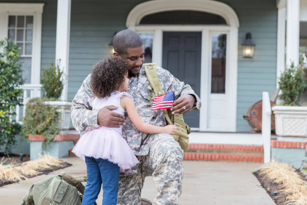 little girl is reunited with her army dad - military lifestyle stock pictures, royalty-free photos & images