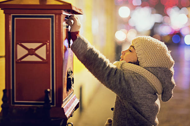 little girl is sending letter in the night - gute nacht text stock-fotos und bilder