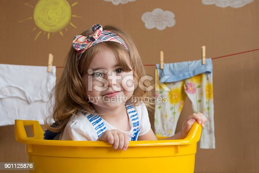 istock little girl is sitting in a yellow bath 901125876