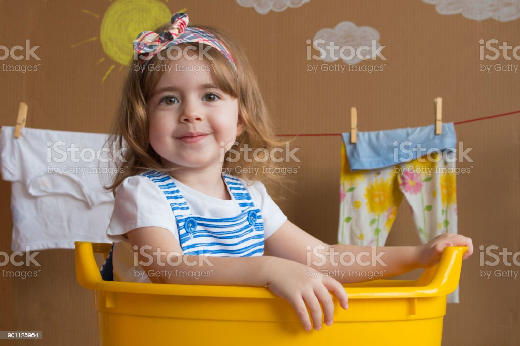 Little Girl Is Sitting In A Yellow Bath Stock Photo & More Pictures ...