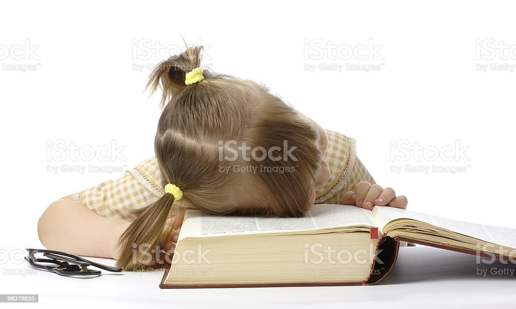 Little girl is sleeping on book, back to school royalty-free stock photo