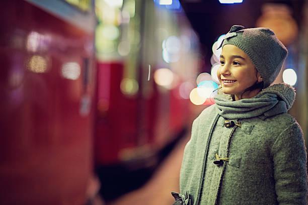 little girl is standing at the station - winter austria train bildbanksfoton och bilder