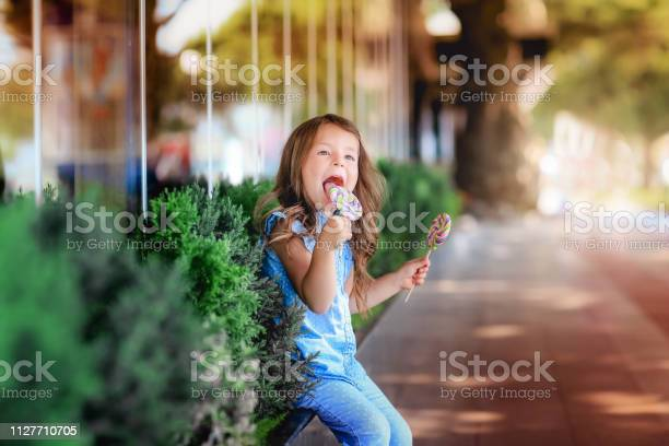 Little girl is taste candy on a stick picture id1127710705?b=1&k=6&m=1127710705&s=612x612&h=1l9tc6usd5boy4bxkvont r8lcvuqj6cccqdnahxnta=