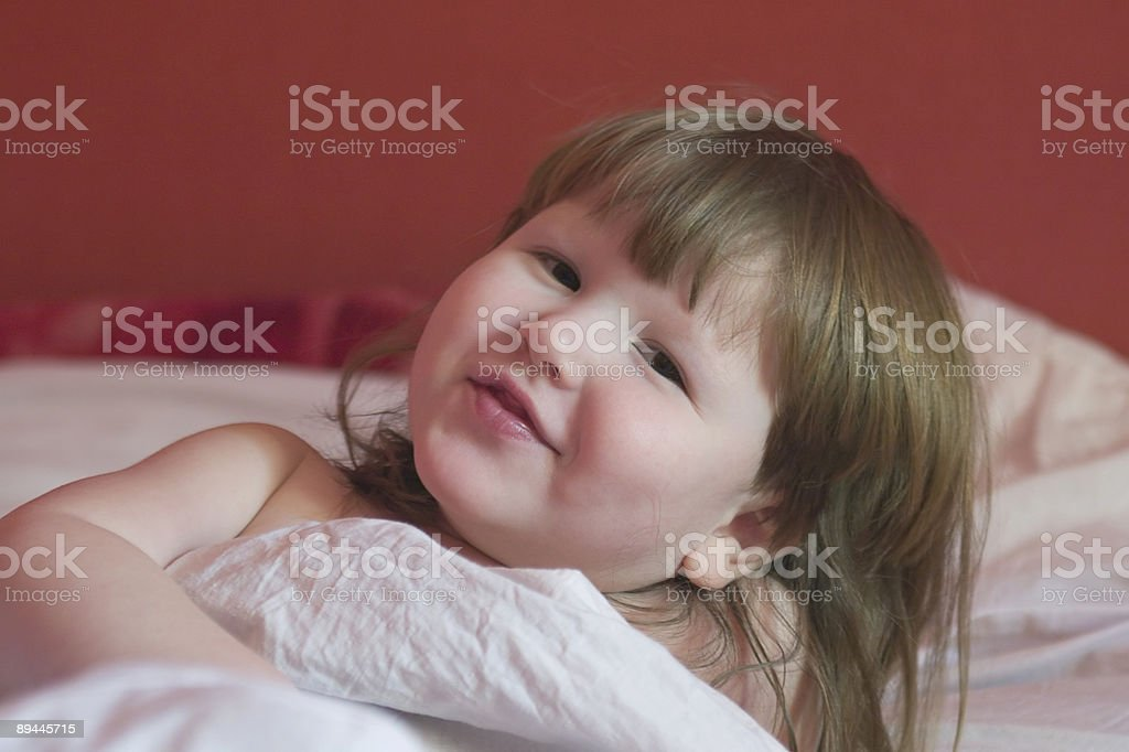 little girl is waking up royalty-free stock photo