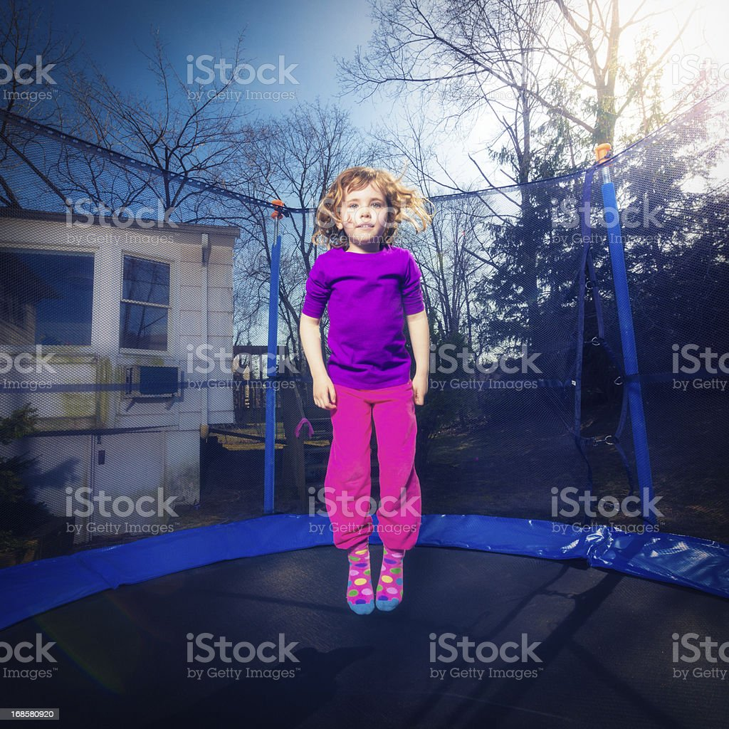 Little girl jumping on trampoline royalty-free stock photo