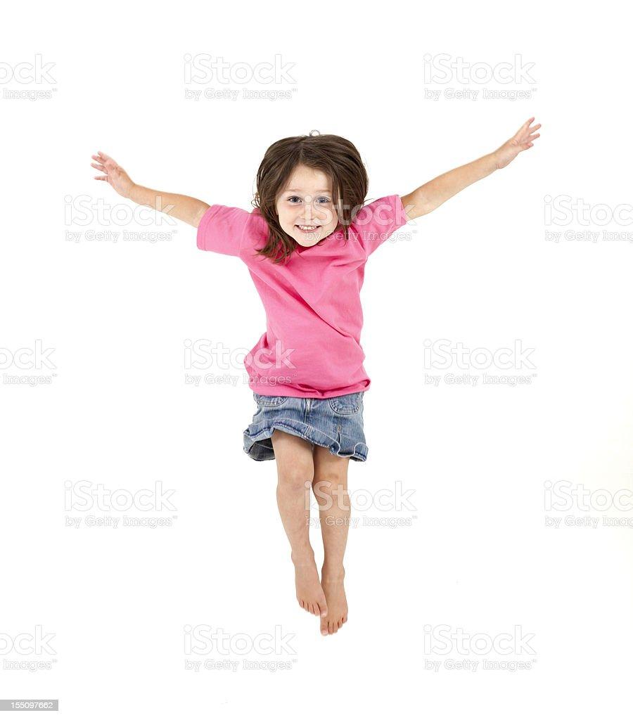 Kleines Mädchen springen auf weißem Hintergrund – Foto