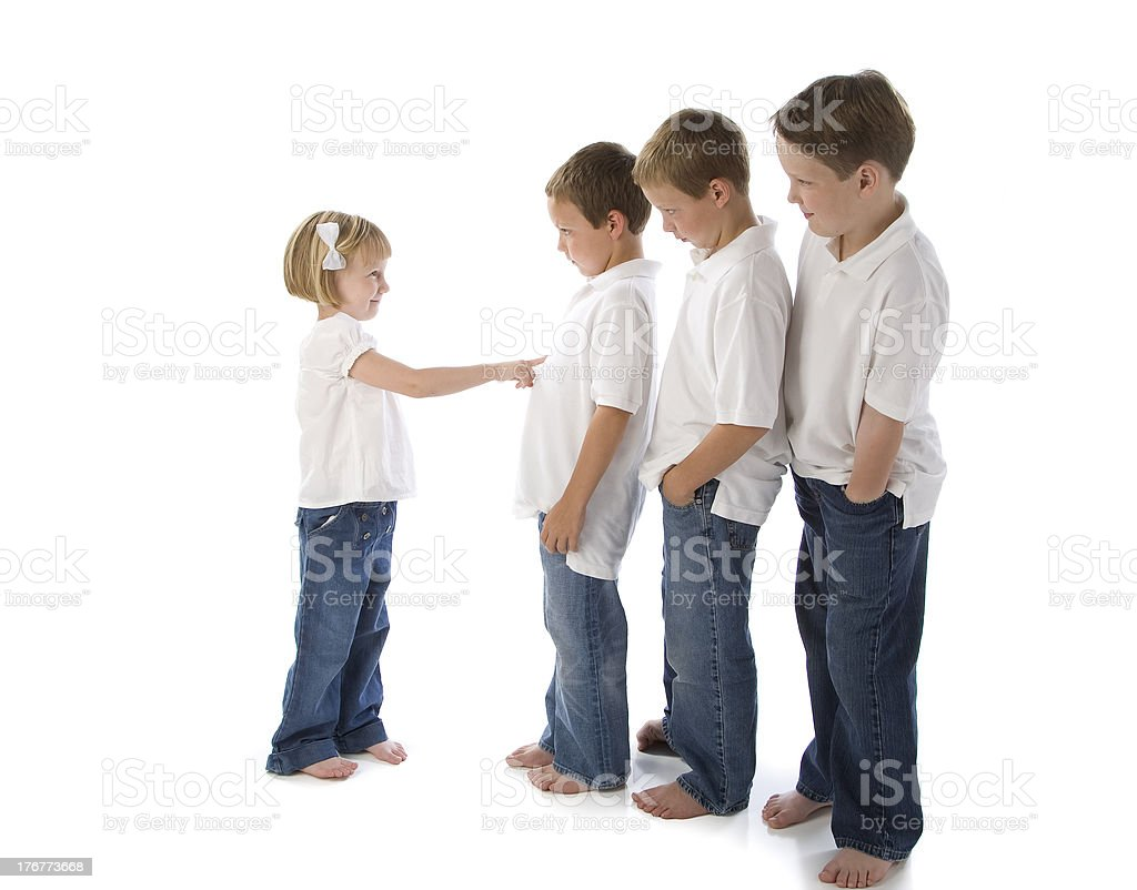 Little Girl Keeps Older Boys in Line royalty-free stock photo