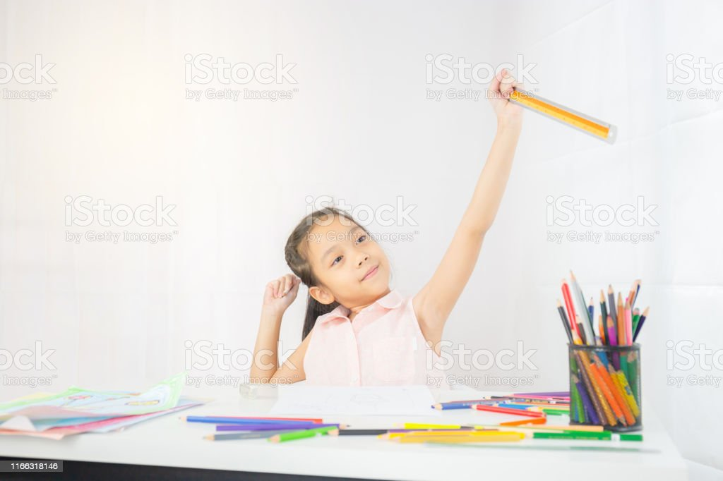Little girl kid drawing picture with colorful pencils, ruler and...