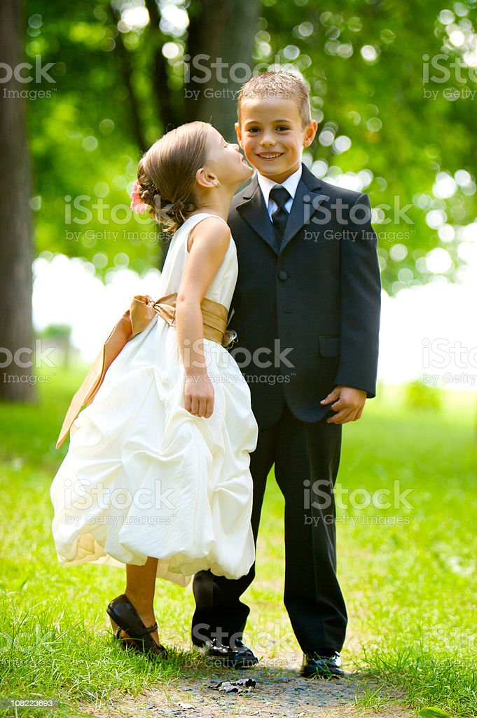 little girl kissing a boy royalty-free stock photo