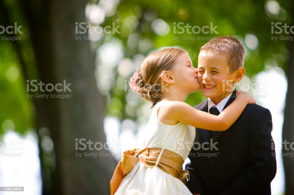 Little Girl Kissing Boy At Wedding Stock Photo  More -6536