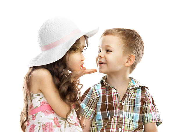 little girl kissing boy isolated over white - little girls little boys kissing love stock photos and pictures