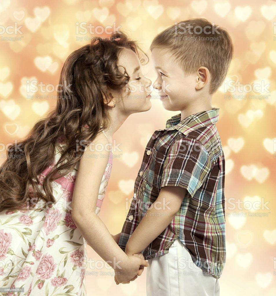Little girl kissing boy stock photo more pictures of affectionate little girl kissing boy royalty free stock photo altavistaventures Choice Image