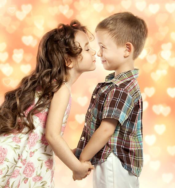 little girl kissing boy stock photo - Pictures For Little Boys