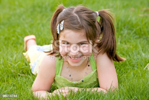 Little Girl Laying In The Grass Laughing Stock Photo & More Pictures of Beautiful People