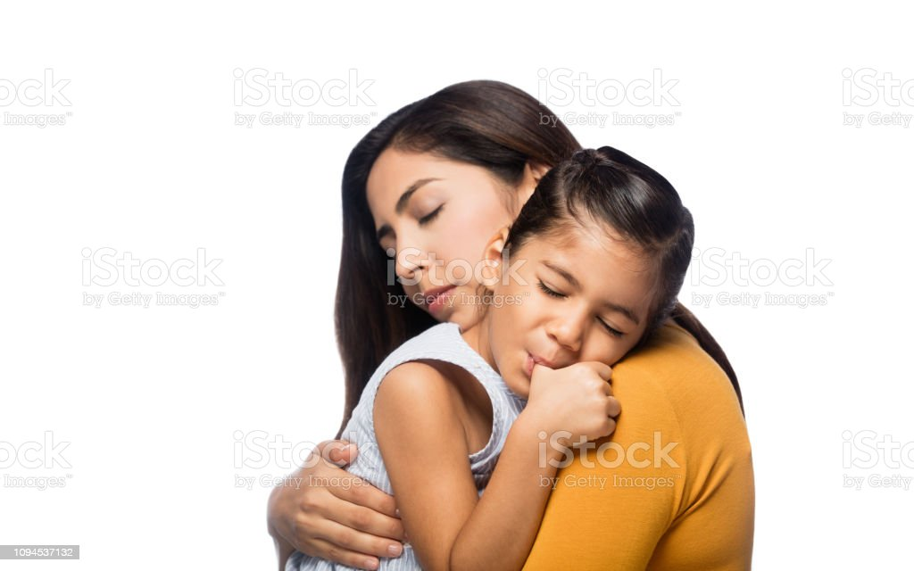 Little girl leaning on mother's shoulder stock photo