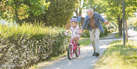istock Little Girl Learning Ride A Bike With Grandfather 853720192