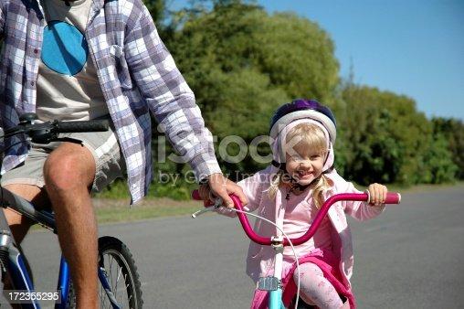 istock Little Girl Learning to Bike Ride 172355295