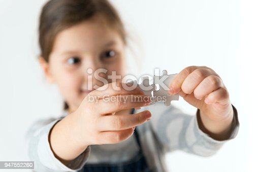 istock Little Girl Learning To Find Solution 947552260