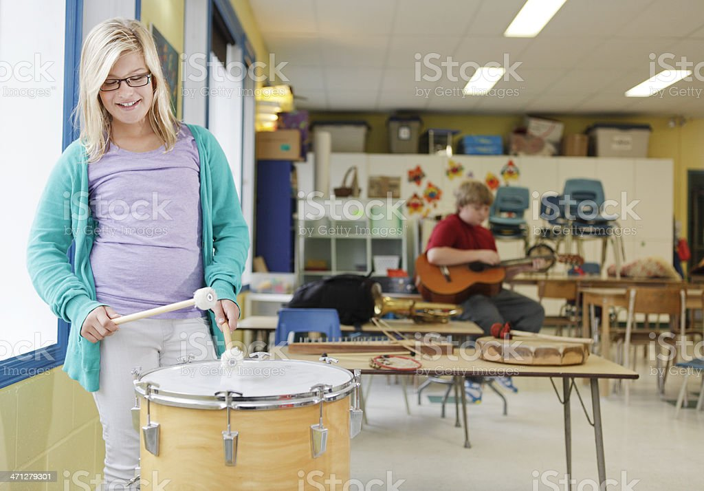 Little Girl Learning to Play a Bass Drum stock photo