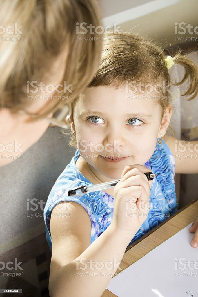 Little girl learns to write royalty-free stock photo