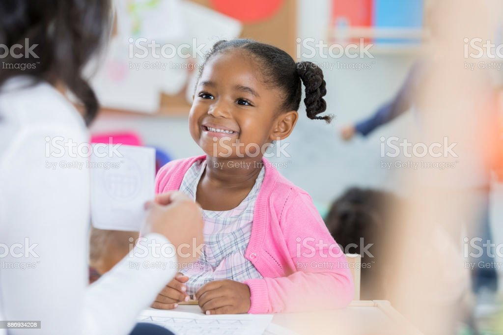 Little girl learns with flash cards at preschool stock photo