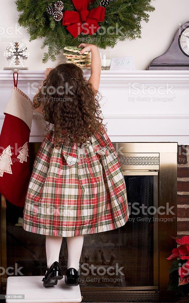 Little Girl Leaving Cookies for Santa stock photo