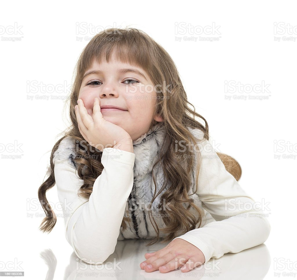 little girl lies on the floor and showing ok sign royalty-free stock photo
