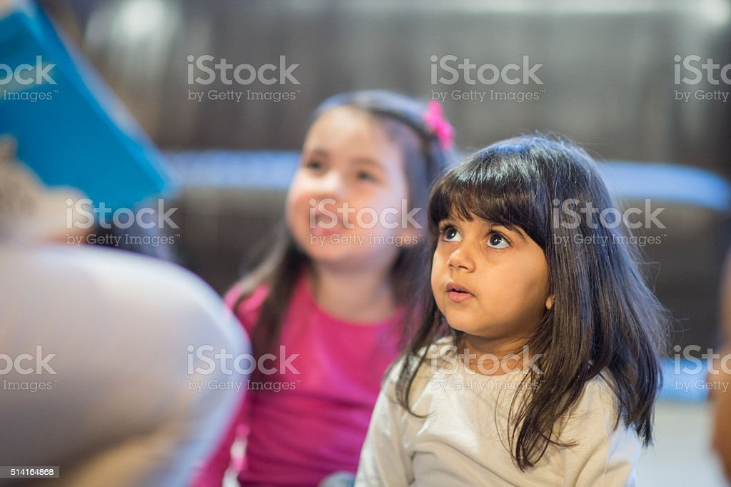 Little Girl Listening to a Story stock photo