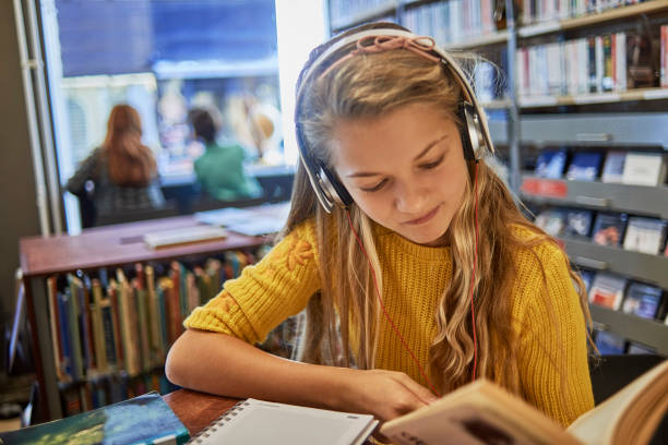 Little girl listening to music and studying picture id1073344038?b=1&k=6&m=1073344038&s=612x612&w=0&h=vhjujbdh121s44weraq5nrbpclm3ky0kvrdng4jap3o=