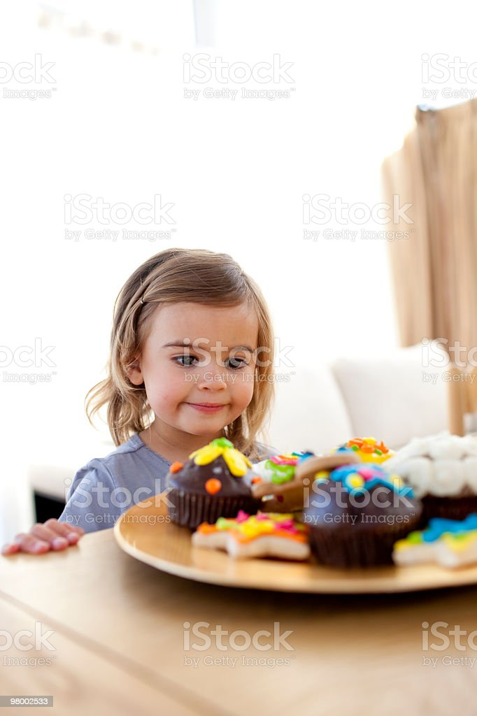 Little girl looking at colorful confectionery royalty-free stock photo