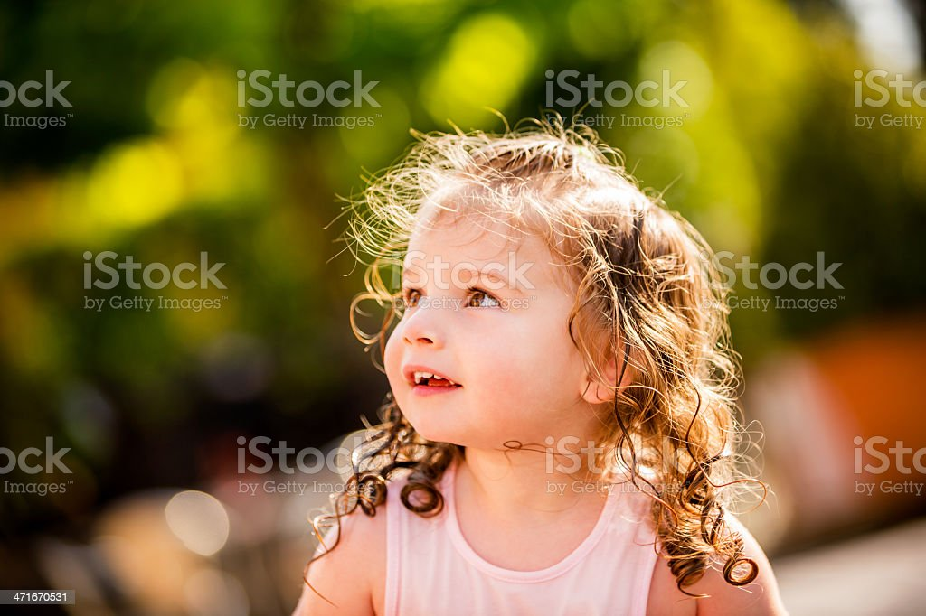 Little girl looking at copy space on a sunny day royalty-free stock photo