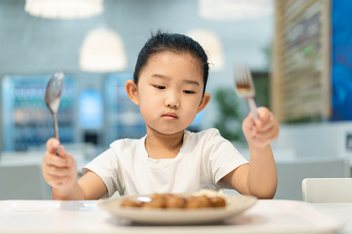 istock Little girl looking at food without appetite 1270235280