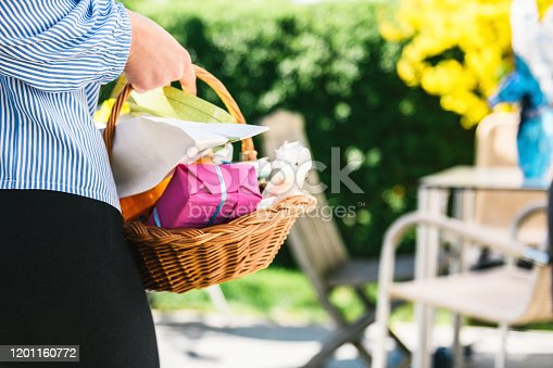 teenage girl girl holding basket with easter gifts in subby garden