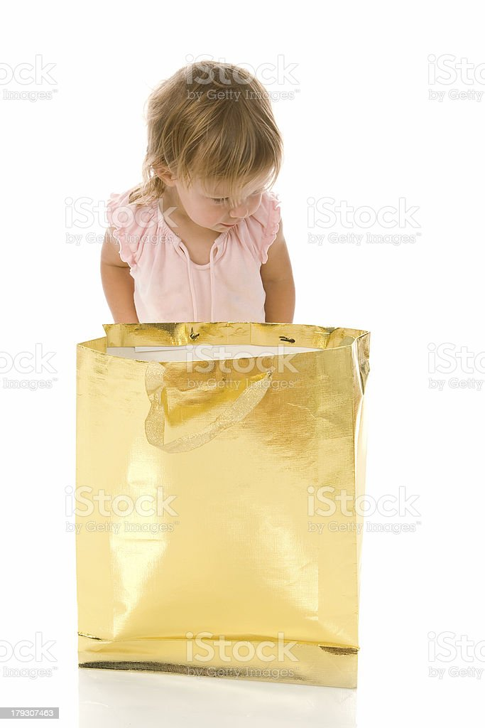 Little Girl Looking in Gift Bag royalty-free stock photo