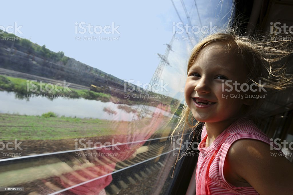 Little girl looking in the window royalty-free stock photo
