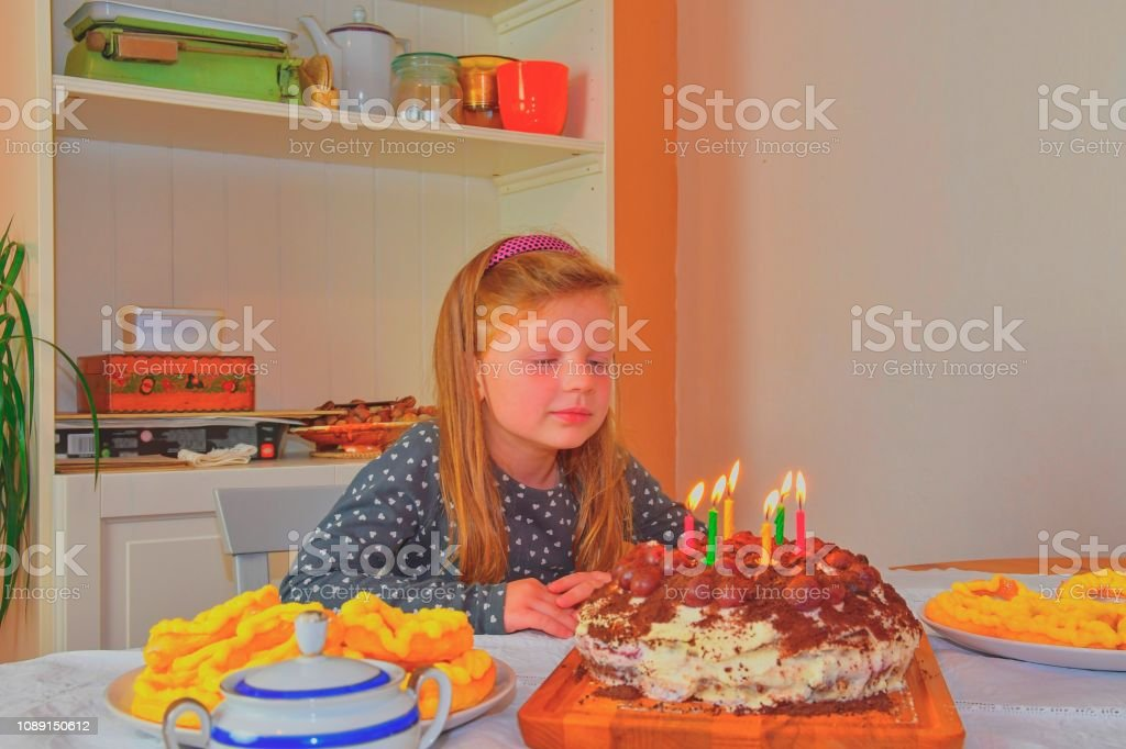 Excellent Little Girl Looking On Her Birthday Cake Small Girl Celebrating Funny Birthday Cards Online Necthendildamsfinfo