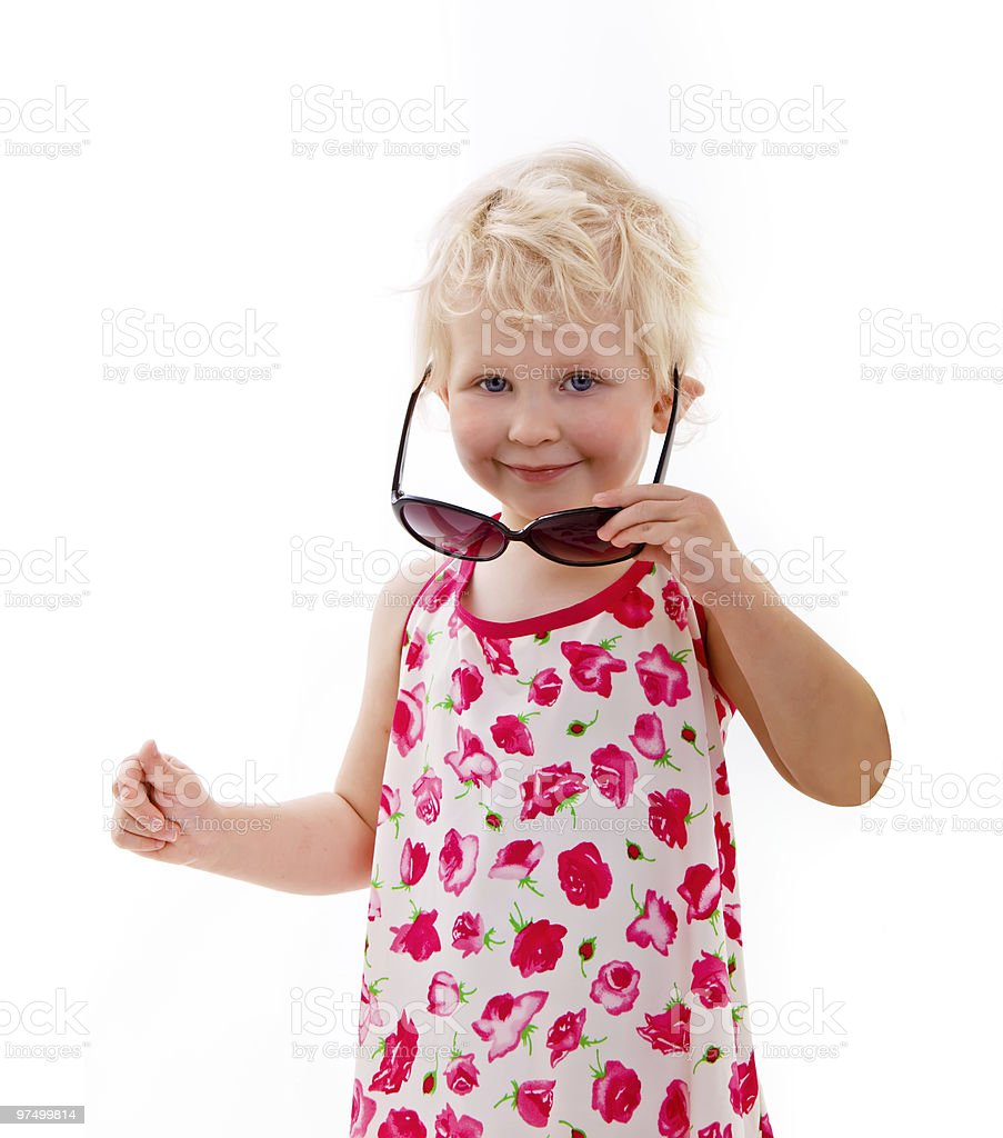 Little girl looking over sunglasses royalty-free stock photo
