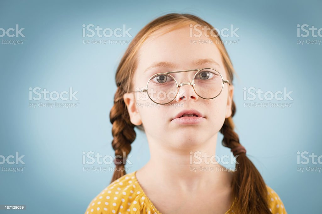 Little Girl Looking Through Her Nerdy Glasses royalty-free stock photo