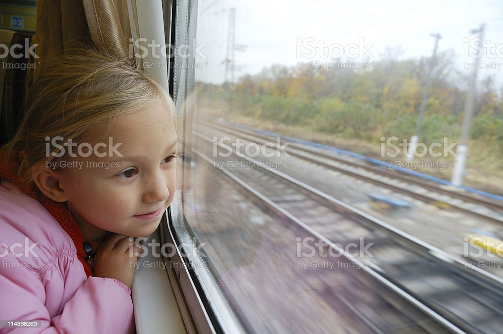 Little girl looking through the train window royalty-free stock photo